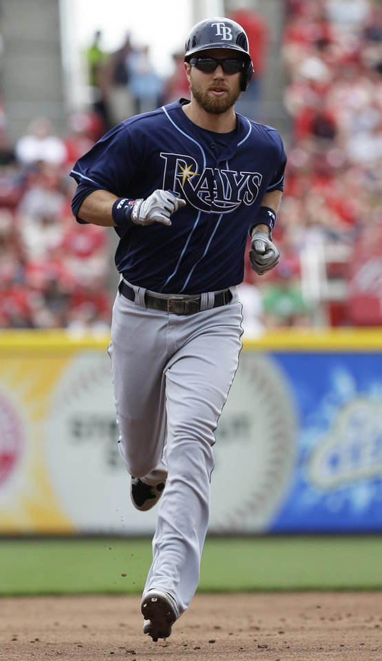 Photo - Tampa Bay Rays' Ben Zobrist rounds the bases after hitting a two-run home run off Cincinnati Reds starting pitcher Tony Cingrani in the third inning of a baseball game, Sunday, April 13, 2014, in Cincinnati. (AP Photo/Al Behrman)