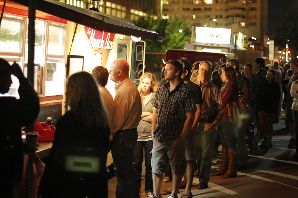 People gather at a food truck near N Hudson Avenue and 8th Street for last year\'s H&8th street market event. Photo by Doug Hoke, The Oklahoman Archives Doug Hoke - THE OKLAHOMAN