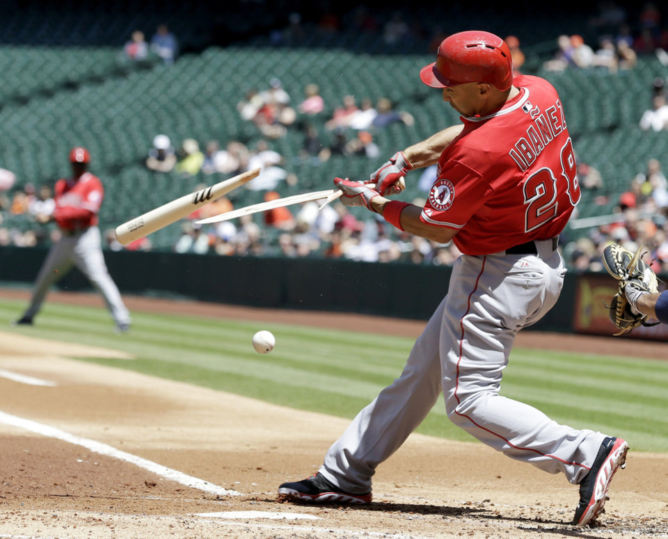 Photo - Los Angeles Angels' Raul Ibanez breaks his bat as he ground out to first with the bases loaded against the Houston Astros in the first inning of a baseball game Monday, April 7, 2014, in Houston. Kole Calhoun scored on the play. (AP Photo/Pat Sullivan)
