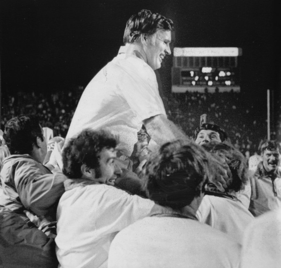 Carried off field after win against Arkansas Sept. 23, 1974: Oklahoma State University (OSU) football coach Jim Stanley