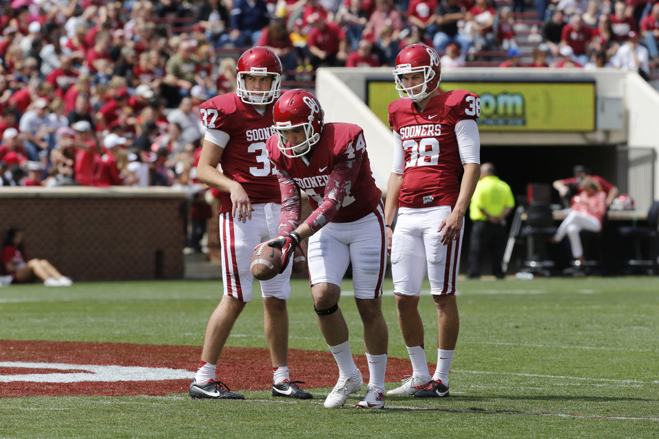 Photo - Kickers Dylan Seibert (37), Jed Barnett (44) and Jack Steed (38) practice during half-time of the annual Spring Football Game at Gaylord Family-Oklahoma Memorial Stadium in Norman, Okla., on Saturday, April 13, 2013. Photo by Steve Sisney, The Oklahoman