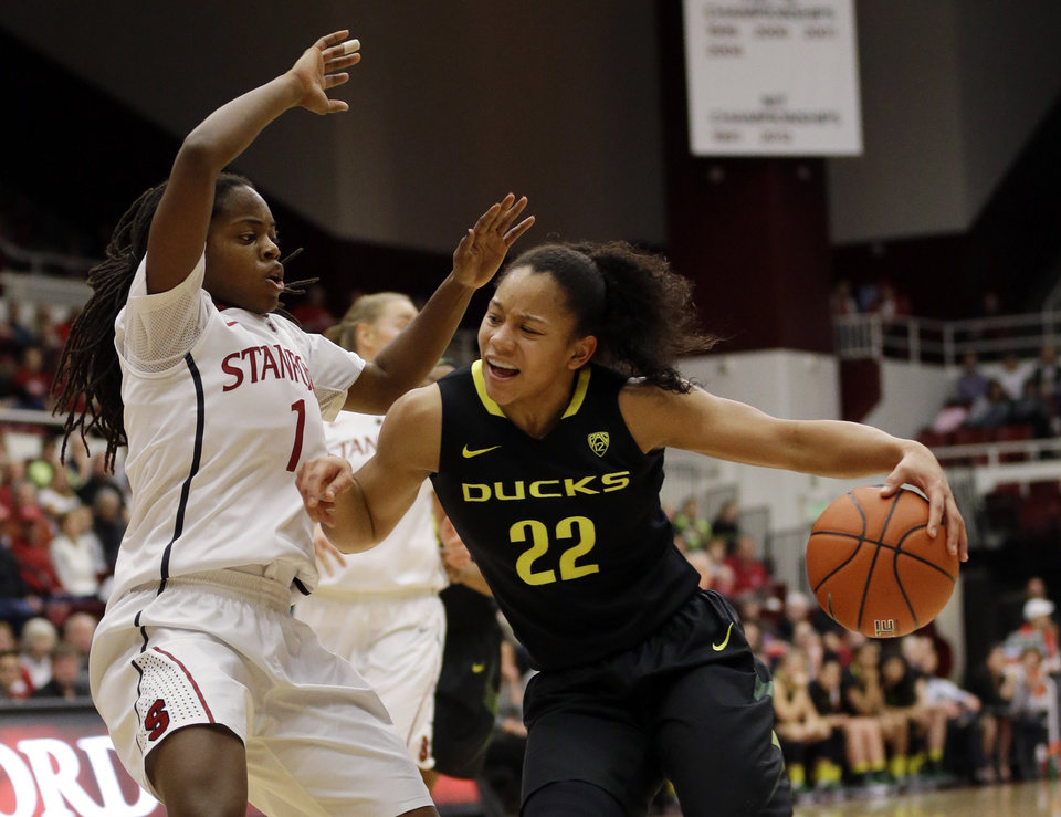 Photo - Oregon's Ariel Thomas (22), right, is defended by Stanford 's Lili Thompson (1) during the first half of an NCAA college basketball game on Friday, Jan. 3, 2014, in Stanford, Calif. (AP Photo/Marcio Jose Sanchez)