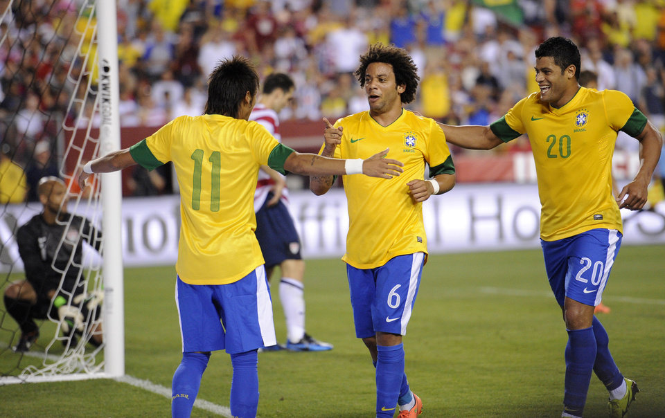 Photo -   Brazil's Marcelo (6) celebrates his goal with Neymar (11) and Hulk (20) during the second half of an international friendly soccer game against the United States, Wednesday, May 30, 2012, in Landover, Md. Brazil won 4-1. (AP Photo/Nick Wass)