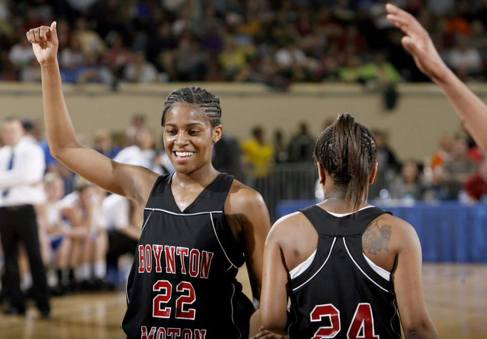 Photo - Boynton-Moton's Breanna Hutchinson celebrates during the final of the Class B girls basketball state tournament  between Cyril and Boynton-Moton at the State Fair Arena, Saturday, March 6, 2010, in Oklahoma City. Photo by Sarah Phipps, The Oklahoman