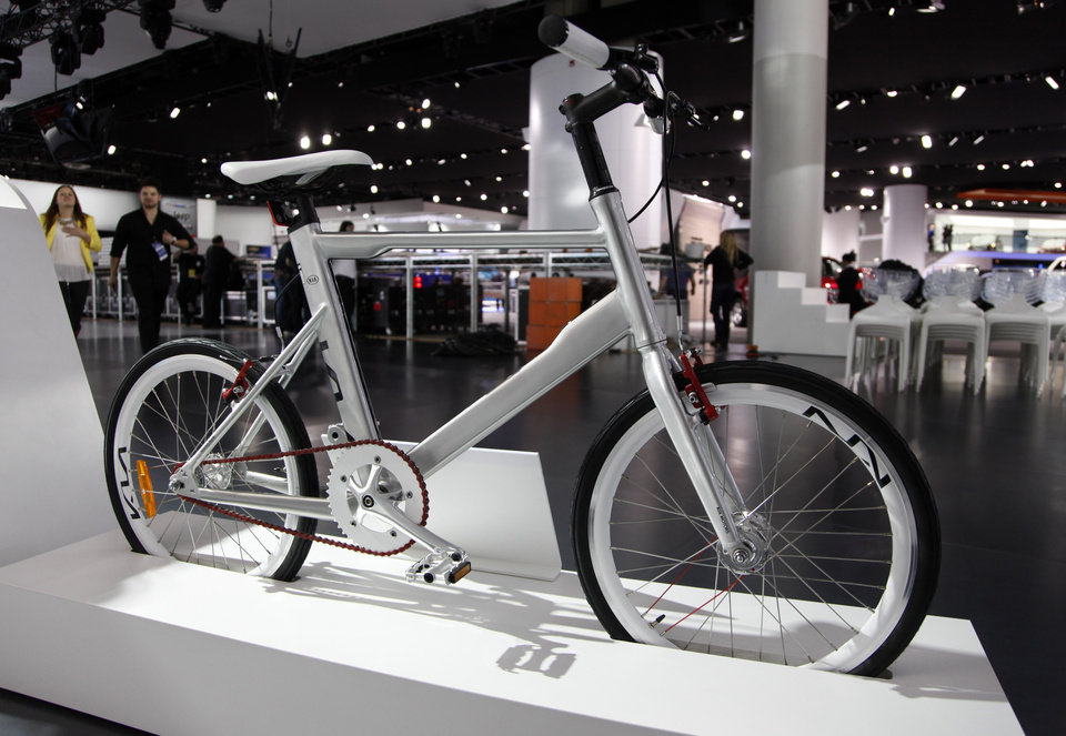 Photo - The K Velo, the first bicycle designed by Kia Motors, under the supervision of Chief Design Officer, Peter Schreyer, is shown on display at the North American International Auto Show in Detroit, Wednesday, Jan. 16, 2013. Transportation of the two-wheeled variety is sharing the floor at the auto show in Detroit along with the latest cars, trucks and concept vehicles. Bikes weren't the focus of presentations during this week's press previews, but they're often used in marketing cars. (AP Photo/Paul Sancya)