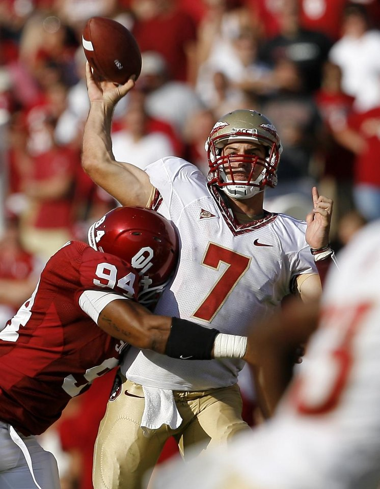Photo - OU's Macon Pryce hits Florida State's Christian Ponder as he throws during the second half of the college football game between the University of Oklahoma Sooners (OU) and Florida State University Seminoles (FSU) at the Gaylord Family-Oklahoma Memorial Stadium on Saturday, Sept. 11, 2010, in Norman, Okla.   Photo by Bryan Terry, The Oklahoman