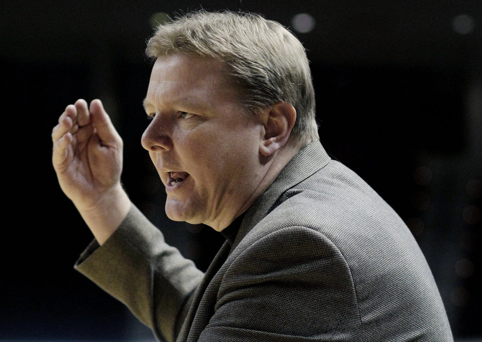 FILE - In this Feb. 19, 2011 file photo, Oklahoma State women\'s basketball coach Kurt Budke makes a point during the second half of an NCAA college basketball game against Texas A&M, in College Station, Texas. Oklahoma State University says Budke and assistant coach Miranda Serna were killed in a plane crash in central Arkansas. The university said in a news release Friday, Nov. 18, 2011 that the two were on a recruiting trip to Arkansas when the plane crashed near Perryville, about 45 miles west of Little Rock. (AP Photo/Pat Sullivan, File) ORG XMIT: NY153