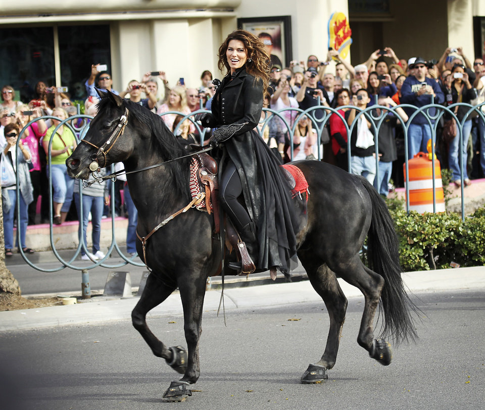 "Shania Twain makes her official arrival on horseback at Caesars Palace in Las Vegas on Wednesday, Nov. 14, 2012. Twain is set to begin a two-year residency at the Colosseum with her show ""Shania: Still the One"" starting Dec. 1. (AP Photo/Las Vegas Review-Journal, Jason Bean) LOCAL TV OUT; LOCAL INTERNET OUT; LAS VEGAS SUN OUT"