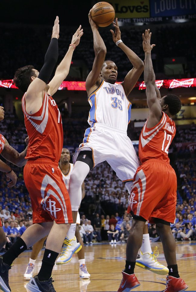Oklahoma City's Kevin Durant (35) passes the ball over Houston's Carlos Delfino (10) and Houston's Patrick Beverley (12) during Game 2 in the first round of the NBA playoffs between the Oklahoma City Thunder and the Houston Rockets at Chesapeake Energy Arena in Oklahoma City, Wednesday, April 24, 2013. Photo by Chris Landsberger, The Oklahoman