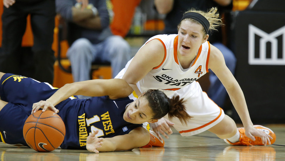 West Virginia's Jess Harlee (14) dives for the ball in front of Oklahoma State's Liz Donohoe (4) during a women's college basketball game between Oklahoma State and West Virginia at Gallagher-Iba Arena in Stillwater, Okla.,  Tuesday, Jan. 29, 2013. West Virginia won 67-61. Photo by Bryan Terry, The Oklahoman