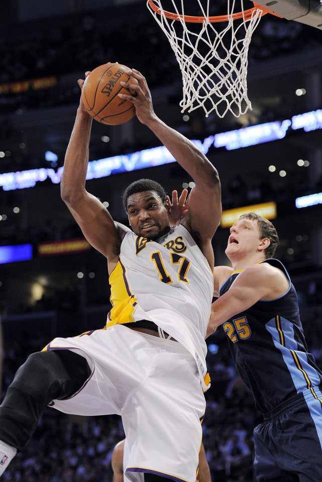 Photo -   Los Angeles Lakers center Andrew Bynum grabs a rebound away from Denver Nuggets center Timofey Mozgov of Russia during the second half of an NBA first-round playoff basketball game, Sunday, April 29, 2012, in Los Angeles. The Lakers won 103-88. (AP Photo/Mark J. Terrill)