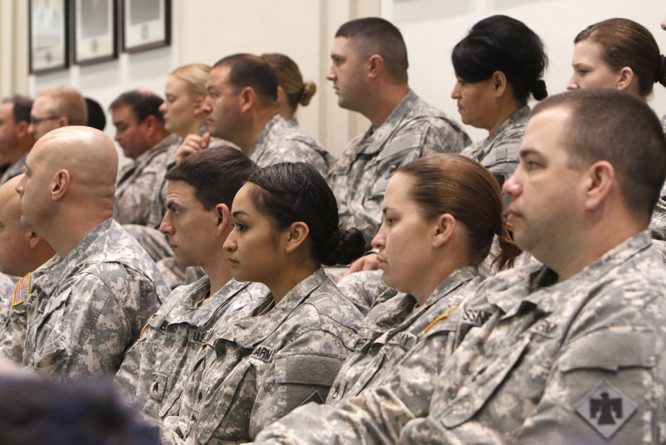 Photo -  Current members of the Oklahoma National Guard and former members of the 45th Infantry (Thunderbird) Division listen to  Deering speak Tuesday on the floor of the Oklahoma House. Photos by Paul Hellstern, The Oklahoman   PAUL HELLSTERN