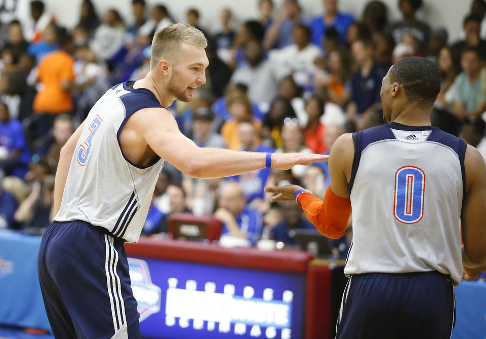 Photo - Oklahoma City's Domantas Sabonis, left, celebrates with Russell Westbrook during the Thunder's annual Blue and White Scrimmage at John Marshall Mid-High School in Oklahoma City, Tuesday, Sept. 27, 2016. Photo by Bryan Terry, The Oklahoman