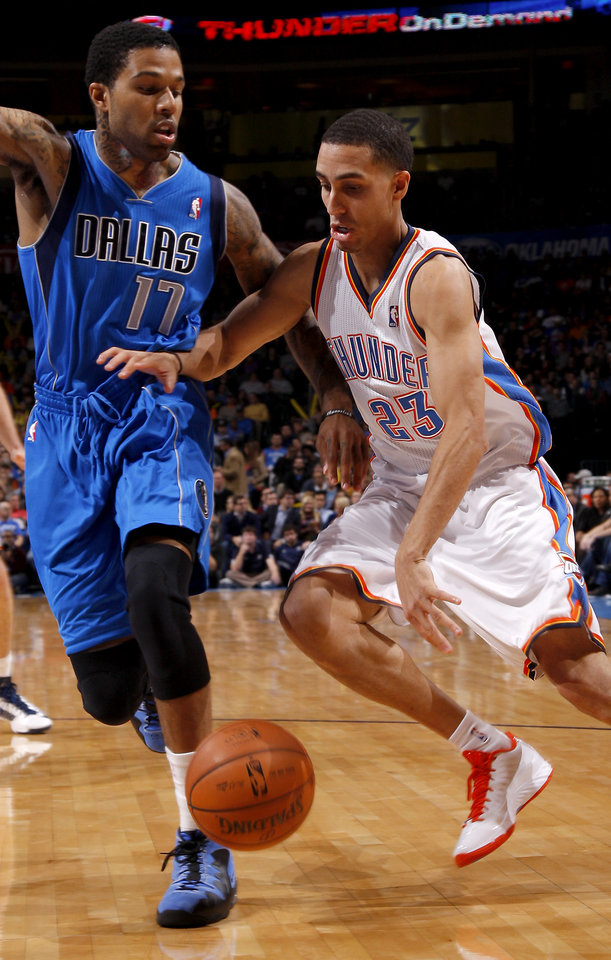 Oklahoma City\'s Kevin Martin (23) drives around Dallas\' Chris Douglas-Roberts during an NBA basketball game between the Oklahoma City Thunder and the Dallas Mavericks at Chesapeake Energy Arena in Oklahoma City, Thursday, Dec. 27, 2012. Photo by Bryan Terry, The Oklahoman