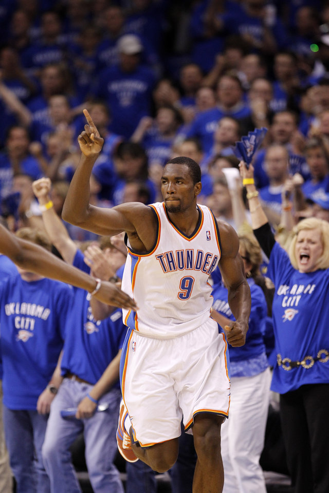 Photo - FILE - This May 23, 2011, file photo shows Oklahoma City Thunder's Serge Ibaka (9) gesturing during Game 4 of the NBA Western Conference finals basketball series against the Dallas Mavericks, in Oklahoma City. Ibaka has been granted Spanish nationality on Friday, July 15, 2011, clearing the way for him to help Spain defend its European championship this summer. The 21-year-old was born in the Republic of Congo but played for Spanish clubs for three years before moving to the NBA in 2009. According to Spanish media reports, he maintains a residence in Barcelona. (AP Photo/Eric Gay, File) ORG XMIT: NY158