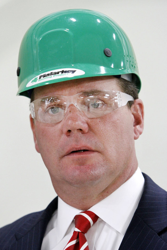 Lt. Governor Todd Lamb wears a hard hat during his tour of Malarkey Roofing Products Friday as part of National Manufacturing Day. <strong>Steve Gooch - The Oklahoman</strong>