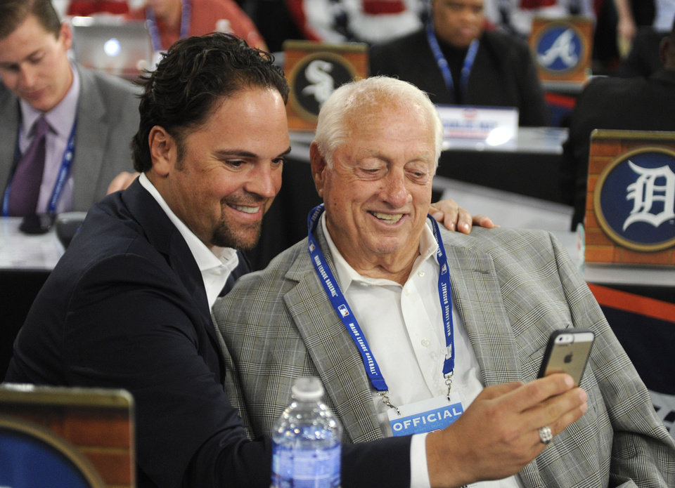 Photo - Former Los Angeles Dodgers' Mike Piazza, left, and Tommy Lasorda take a picture of themselves before the 2014 MLB baseball draft, Thursday, June 5, 2014, in Secaucus, N.J. (AP Photo/Bill Kostroun)