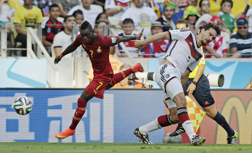 Photo - Ghana's Christian Atsu, left, gets away from Germany's Mats Hummels during the group G World Cup soccer match at the Arena Castelao in Fortaleza, Brazil, Saturday, June 21, 2014. (AP Photo/Matthias Schrader)