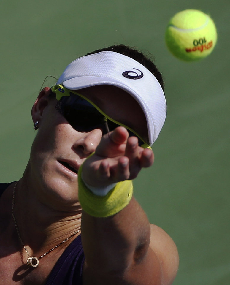 Photo - Samantha Stosur, of Australia, serves against Lauren Davis, of the United States, during the first round of the 2014 U.S. Open tennis tournament, Tuesday, Aug. 26, 2014, in New York. (AP Photo/Elise Amendola)