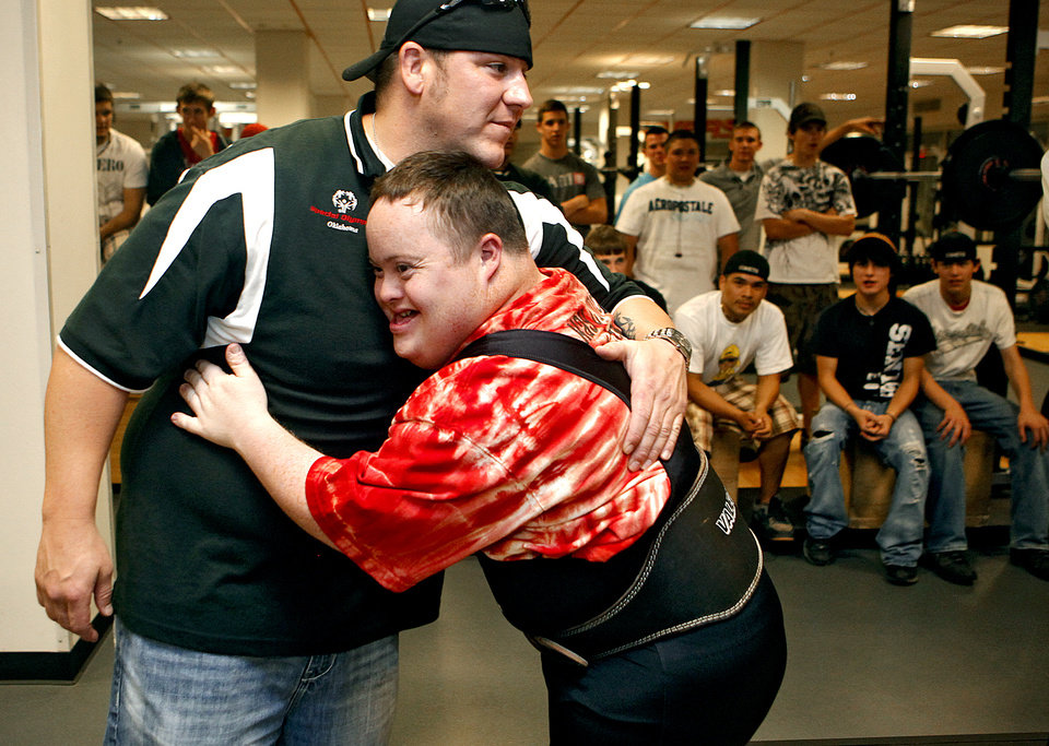 Lifter Ben Grubb gets a hug from his coach Shane Swords after Grubb's squat during the powerlifting competition for the Special Olympics at Oklahoma State University (OSU) on Wednesday, May 13, 2009, in Stillwater, Okla.   Photo by Chris Landsberger, The Oklahoman