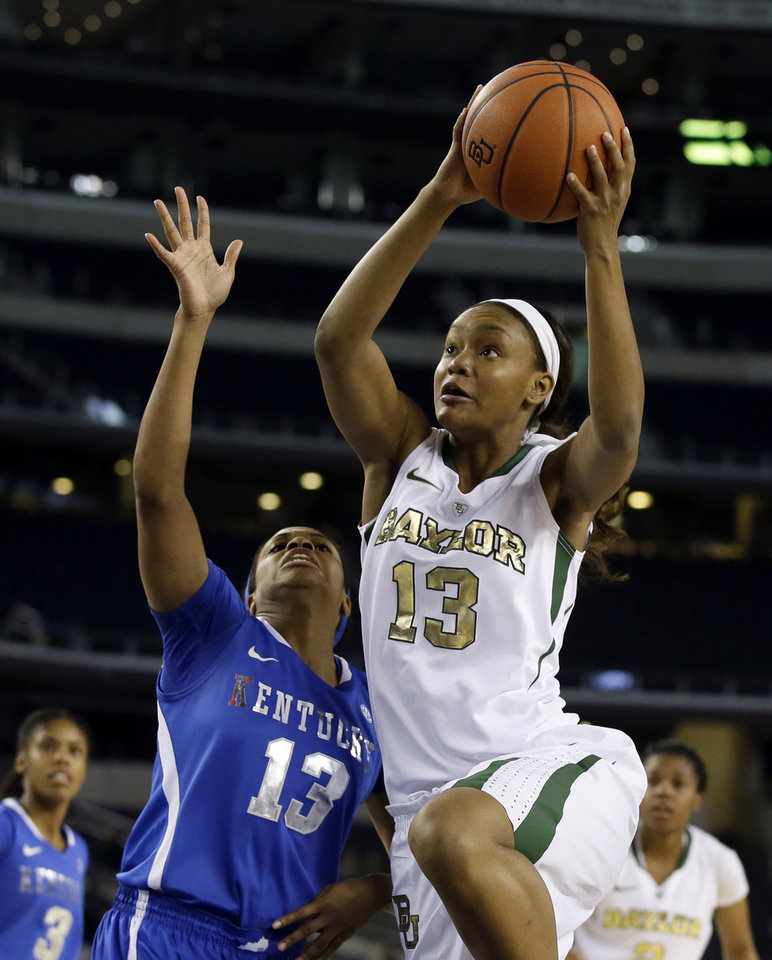 Kentucky guard Bria Goss, left front, defends as Baylor's Nina Davis, right front, goes up for a shot-attempt in the first half of an NCAA college basketball game on Friday, Dec. 6, 2013, in Arlington, Texas. (AP Photo/Tony Gutierrez)