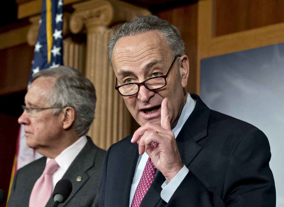 Sen. Charles Schumer, D-N.Y., right, accompanied by Senate Majority Leader Harry Reid of Nev., gestures during a news conference on Capitol Hill in Washington, Thursday, Nov. 29, 2012, after talks with Treasury Secretary Timothy Geithner on the fiscal cliff negotiations.  (AP Photo/J. Scott Applewhite)