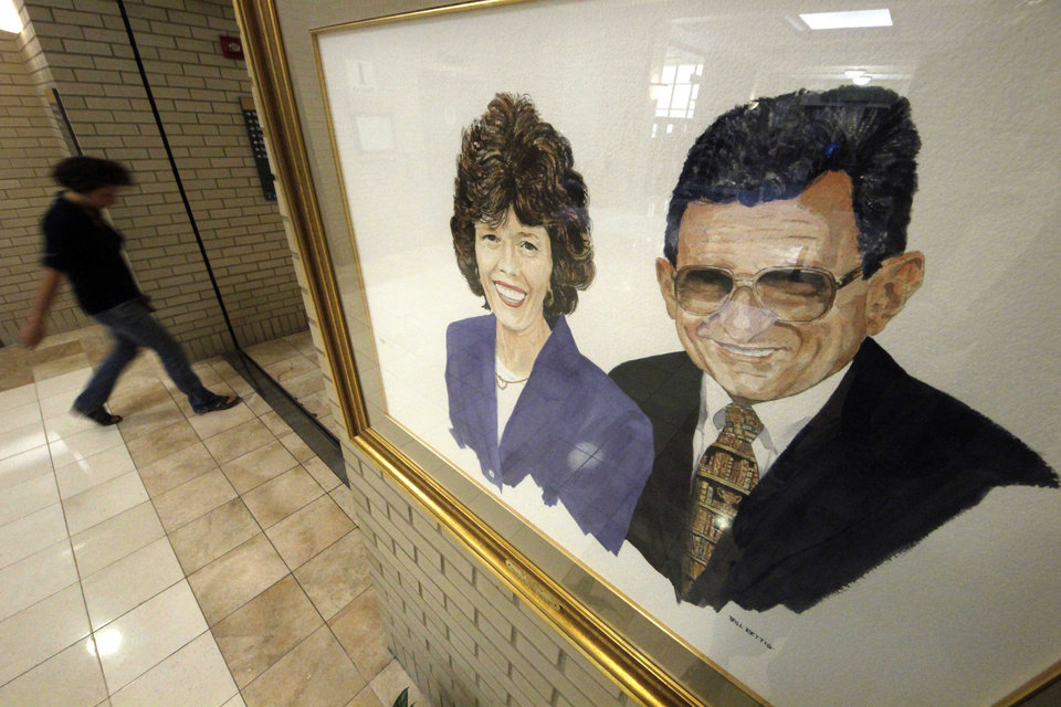 Photo -   A portrait of Sue and Joe Paterno by artist Bill Rettig hangs in the Pattee and Paterno Library on the main campus of Penn State University in State College, Pa., Friday, July 13, 2012. After an eight-month inquiry, Former FBI director Louis Freeh's firm produced a 267-page report that concluded that Paterno and other top Penn State officials hushed up child sex abuse allegations against former Penn State assistant football coach Jerry Sandusky for more than a decade for fear of bad publicity, allowing Sandusky to prey on other youngsters. (AP Photo/Gene J. Puskar)
