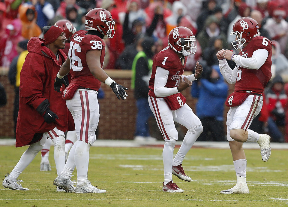 Photo - Oklahoma's Baker Mayfield (6) celebrates wth, Jarvis Baxter (1), Dimitri Flowers (36), and Dede Westbrook (11) after a touchdown pass during the Bedlam college football game between the Oklahoma Sooners (OU) and the Oklahoma State Cowboys (OSU) at Gaylord Family - Oklahoma Memorial Stadium in Norman, Okla., Saturday, Dec. 3, 2016. Oklahoma won 38-20. Photo by Bryan Terry, The Oklahoman