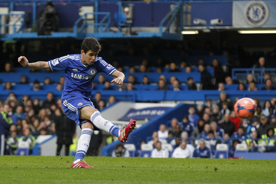 Photo - Chelsea's Oscar scores against Stoke City during their English FA Cup fourth round soccer match at Stamford Bridge, London, Sunday, Jan. 26, 2014. (AP Photo/Sang Tan)