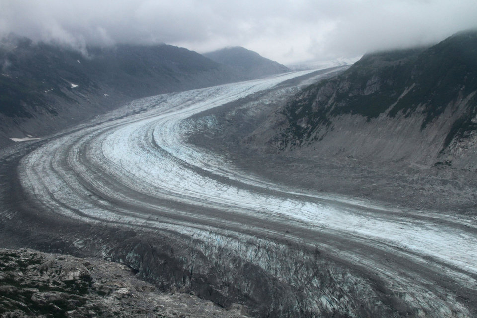 Photo - This July 5, 2013 photo shows a glacier in Lake Clark Pass near Port Alsworth, Alaska. Many float planes will fly through the pass as they take day-trippers to Katmai National Park and Preserve to see the brown bears. (AP Photo/Mark Thiessen)