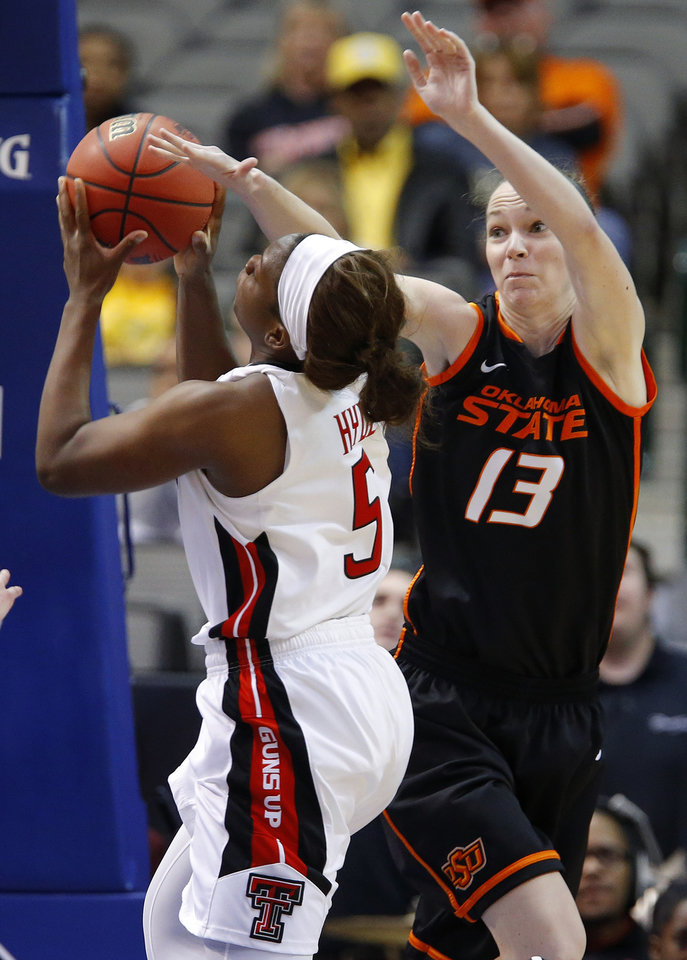 Photo - Oklahoma State's Morgan Toben (13) defends Texas Tech's Christine Hyde (5) during the Big 12 tournament women's college basketball game between Oklahoma State University and Texas Tech University at American Airlines Arena in Dallas, Saturday, March 9, 2012. Oklahoma State won 59-54.  Photo by Bryan Terry, The Oklahoman