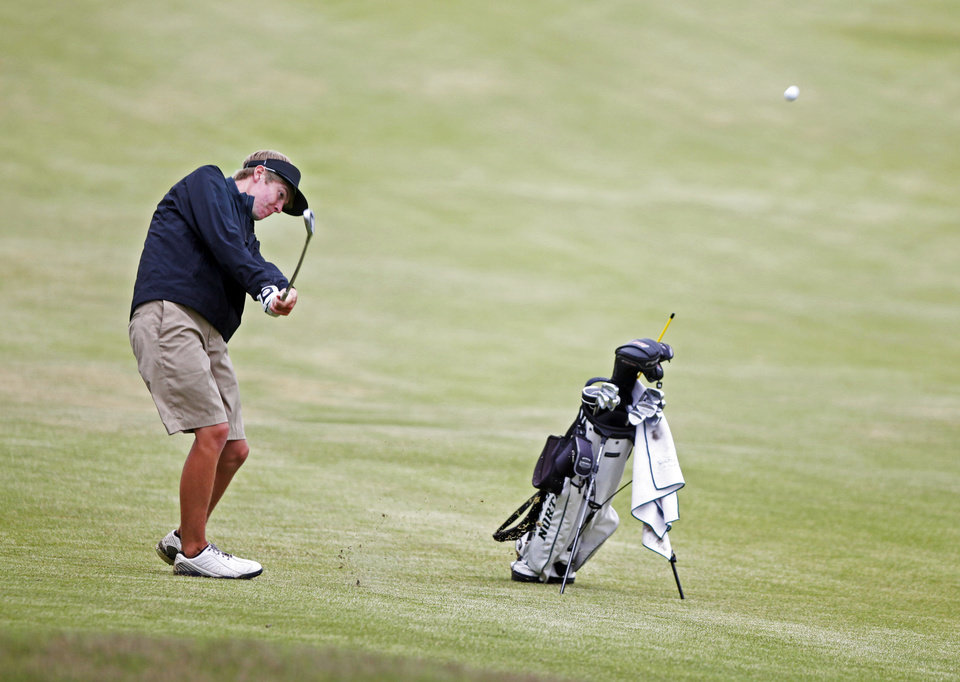 Photo - Connor Mears of North North hits the ball on the fairway at the 6A Golf State Championship at Karsten Creek, Monday, May 12, 2014, in Stillwater. Photo by KT King, For The Tulsa World