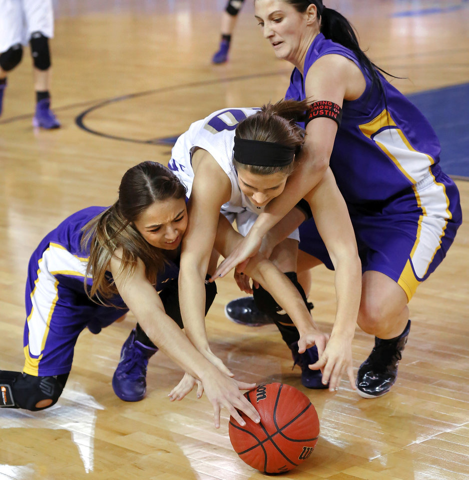 Photo - Okarche's Morgan Vogt, center, is tangled with Red Oak players Paige Campagna, left, and Myranda Rowland as they battle for possession of a loose ball during Class B girls high school basketball championship game in the Jim Norick Arena at State Fair Park on  Saturday, March 8, 2014. Okarche defeated Red Oak, 66-41. Photo by Jim Beckel, The Oklahoman
