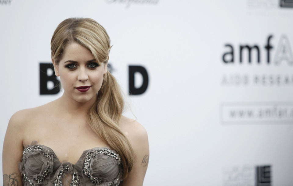 Photo - FILE - In this Thursday, May 21, 2009, file photo, British socialite Peaches Geldof arrives for the amfAR Cinema Against AIDS benefit at the Hotel du Cap-Eden-Roc, during the 62nd Cannes International film festival, in Antibes, southern France. Entertainer Bob Geldof's agent says his 25-year-old daughter Peaches has died. (AP Photo/Matt Sayles, File)