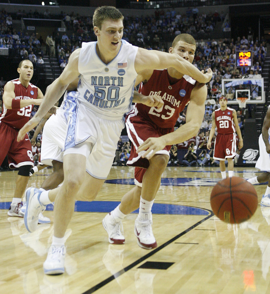 Photo - North Carolina's Tyler Hansbrought (50) and Oklahoma's Blake Griffin (23) battle for a loose ball during the first half in the Elite Eight game of NCAA Men's Basketball Regional between the University of North Carolina and the University of Oklahoma at the FedEx Forum on Sunday, March 29, 2009, in Memphis, Tenn.