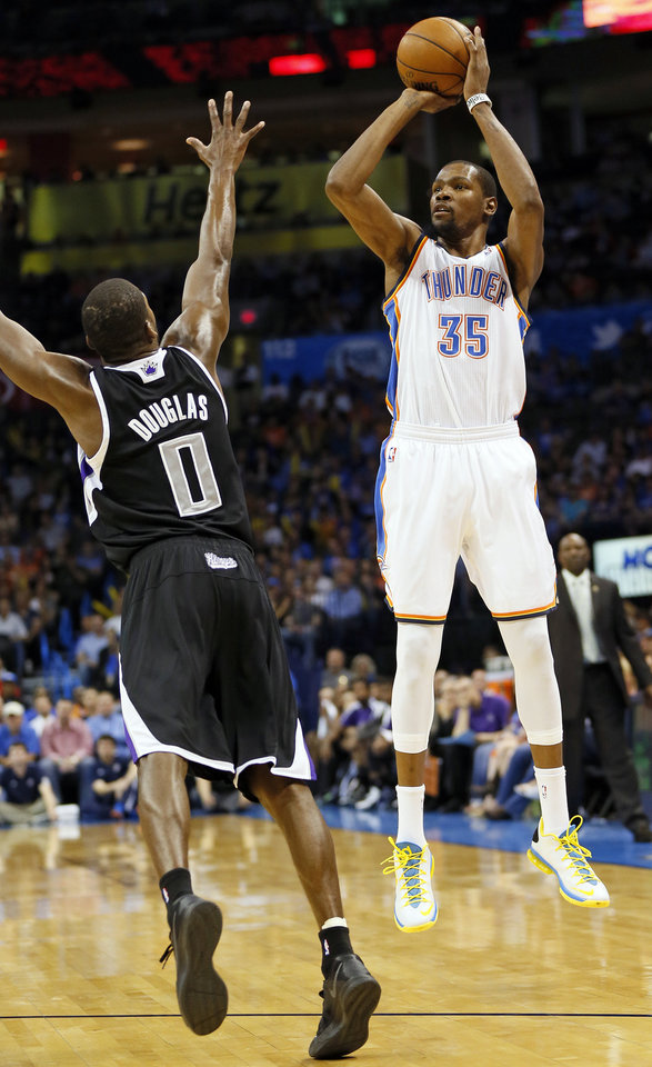Oklahoma City's Kevin Durant (35) shoots over Sacramento's Toney Douglas (0) during an NBA basketball game between the Oklahoma City Thunder and the Sacramento Kings at Chesapeake Energy Arena in Oklahoma City, Monday, April 15, 2013. Photo by Nate Billings, The Oklahoman