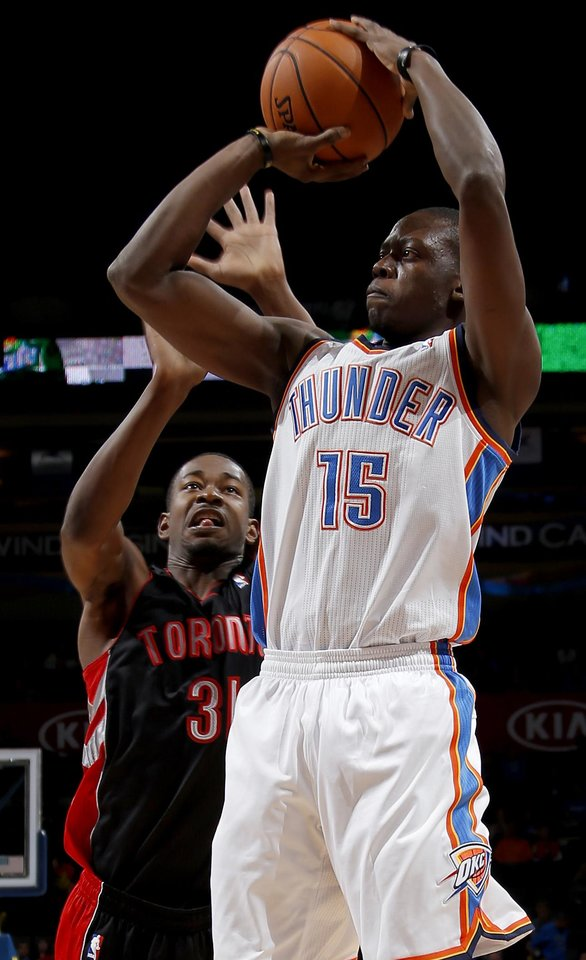Photo - Oklahoma City's Reggie Jackson (15) shoots the ball in front of Toronto's Terrence Ross (31) during an NBA basketball game between the Oklahoma City Thunder and the Toronto Raptors at Chesapeake Energy Arena in Oklahoma City, Tuesday, Nov. 6, 2012.  Tuesday, Nov. 6, 2012. Oklahoma City won 108-88. Photo by Bryan Terry, The Oklahoman