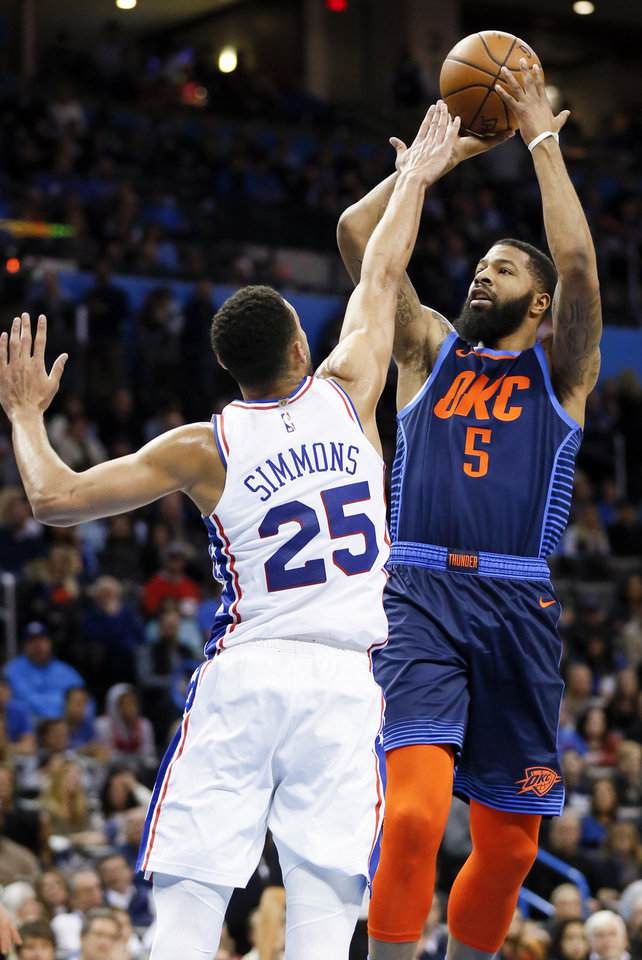 Photo - Oklahoma City's Markieff Morris (5) shoots over Philadelphia's Ben Simmons (25) in the second quarter during an NBA basketball game between the Philadelphia 76ers and the Oklahoma City Thunder at Chesapeake Energy Arena in Oklahoma City, Thursday, Feb. 28, 2019. Photo by Nate Billings, The Oklahoman