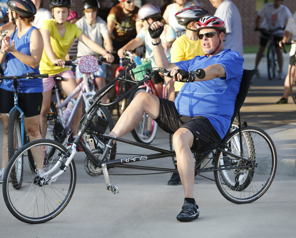 Judge William C. Hetherington, Jr. gets ready for the start of the Norman Conquest bicycle ride on Saturday, July 14, 2012 in Norman, Okla. The ride attended by over 650 entries is sponsored by the Bicycle League of Norman and benefits the J.D. McCarty Center. Photo by Steve Sisney, The Oklahoman