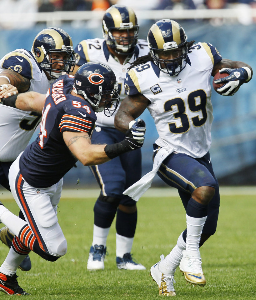 Photo -   St. Louis Rams running back Steven Jackson (39) is chased by Chicago Bears linebacker Brian Urlacher (54) in the second half of an NFL football game in Chicago, Sunday, Sept. 23, 2012. The Bears won 23-6. (AP Photo/Charles Rex Arbogast)