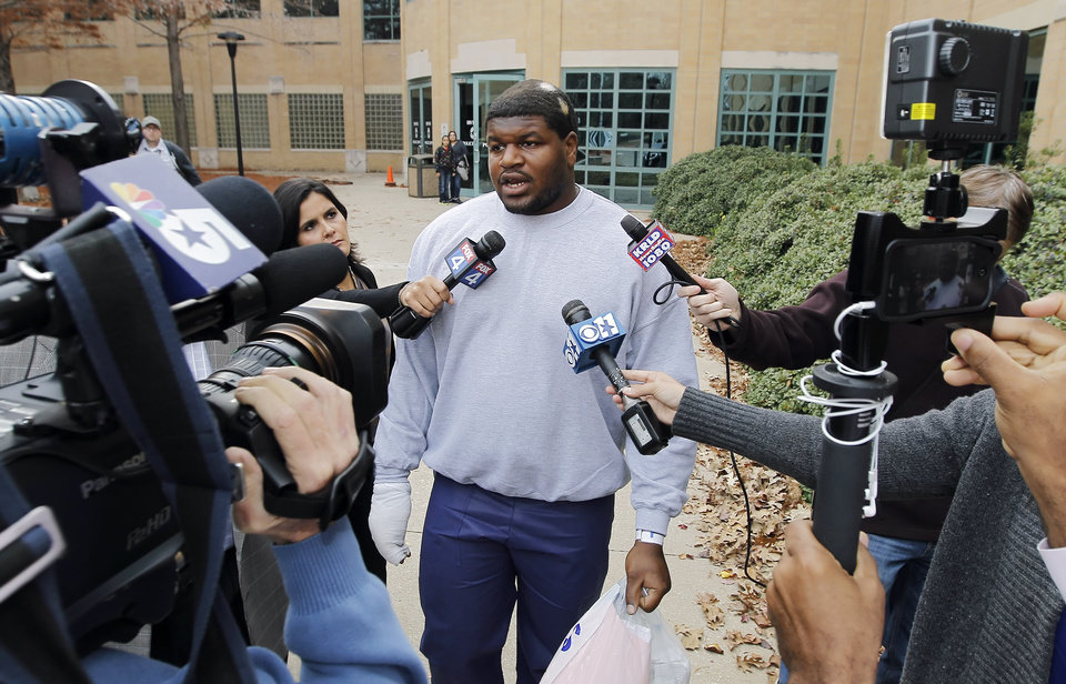 Photo - Dallas Cowboys nose tackle Joshua Brent talks to the media after his release from the Irving City Jail after posting a $500,000 bond, Saturday, Dec. 9, 2012. Brent is charged with intoxication manslaughter after a Saturday morning crash resulted in the death of his passenger, teammate Jerry Brown.