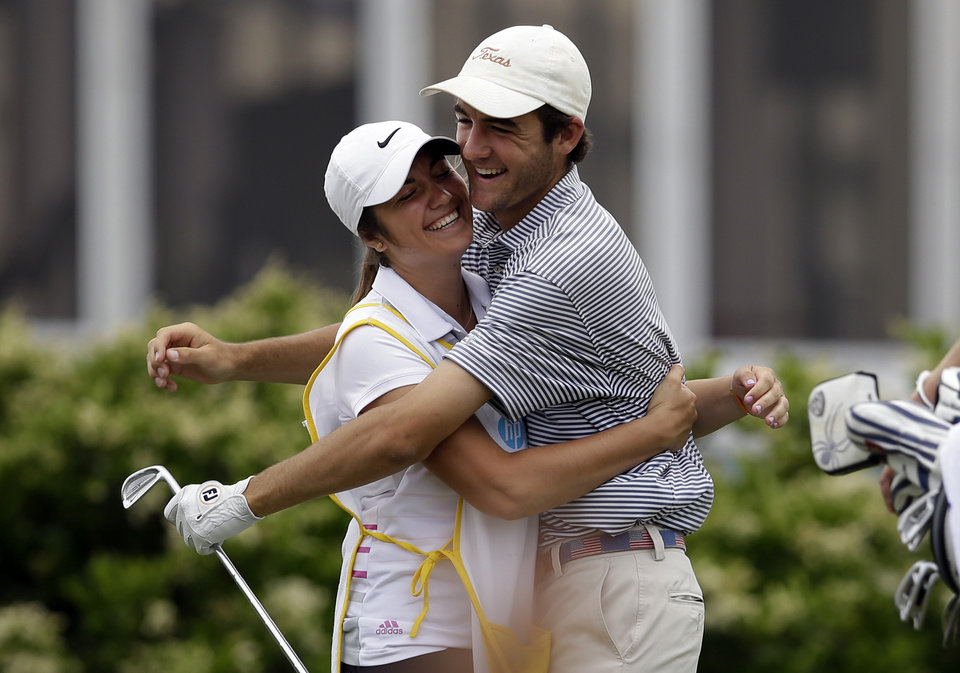 Photo - Scottie Scheffler, 17, of Highland Park High School in Dallas, is hugged by his sister Callie, who is his caddie, after Scheffler sunk a hole-in-one on a 218-yard second hole during the third round of the Byron Nelson Championship golf tournament, Saturday, May 17, 2014, in Irving, Texas. Scheffler is playing in the tournament on a sponsor execption. (AP Photo/Tony Gutierrez)