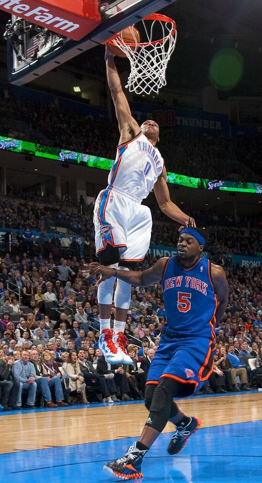 Photo - Oklahoma City's Russell Westbrook (0) dunks the ball over New York's Bill Walker (5) during the NBA game between the Oklahoma City Thunder and the New York Knicks at Chesapeake Energy Arena in Oklahoma CIty, Saturday, Jan. 14, 2012. Photo by Bryan Terry, The Oklahoman