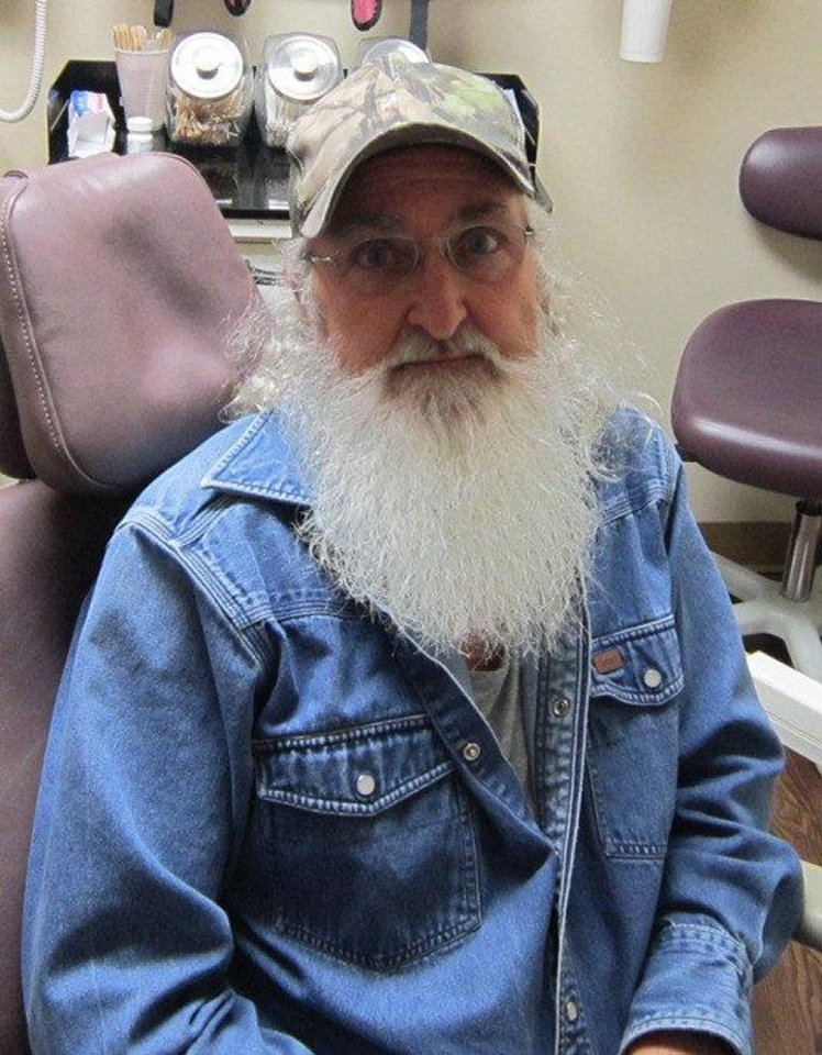 Photo - Roger Blakemore is a patient at Good Shepherd Community Clinic in Ardmore. He received new teeth and a haircut. This is his before picture. Photo provided.