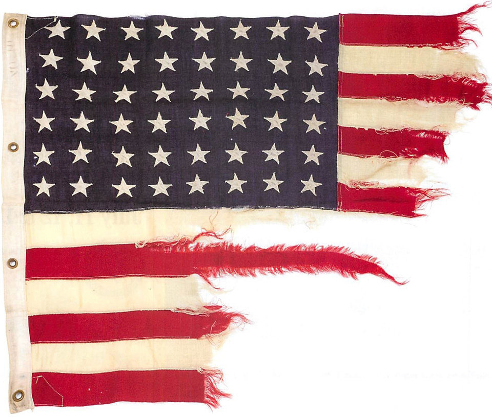This photo provided by Bonhams shows a tattered 48-star American flag that flew aboard the U.S.-built LST 493 on D-Day that is being auctioned by Bonhams in New York on Thursday, June 5, 2014. The flag is among the hundreds of D-Day and other World War II artifacts being auctioned a day before the 70th anniversary of the history-changing invasion. The auction also features rare print-outs of the original series of hourly Dow Jones news bulletins with some of the first reports of the fighting on France's north coast on June 6, 1944. (AP Photo/Bonhams)