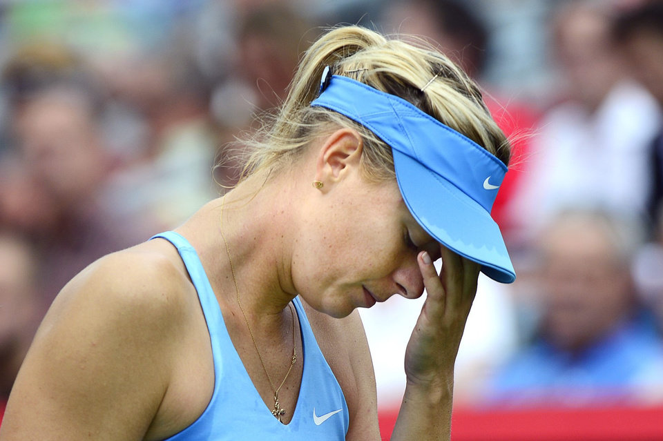 Photo - Maria Sharapova, of Russia, reacts during her round of sixteen match against Carla Suarez Navarro, of Spain, at the Rogers Cup tennis tournament Thursday, Aug. 7, 2014 in Montreal. (AP Photo/The Canadian Press, Paul Chiasson)