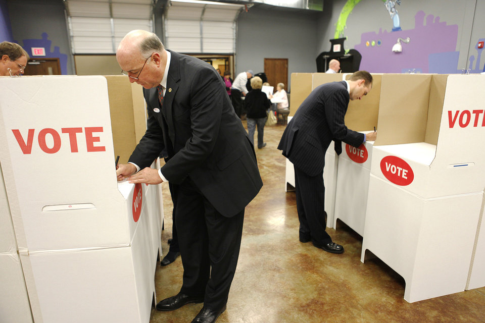 Photo - Oklahoma County Commissioner Ray Vaughn (left) votes at the polling place at the SpringCreek Assembly of God in Edmond, OK, Tuesday, Nov. 2, 2010. By Paul Hellstern, The Oklahoman ORG XMIT: KOD