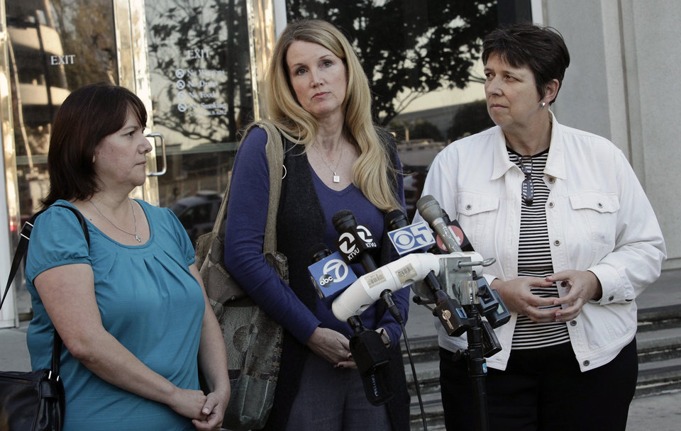 Jurors, from left, Christina Rodriguez, Susan LaGassa and Kathy Ericksen speak to reporters following a guilty verdict in the trial of former O.B. Whaley Elementary School principal Lyn Vijayendran at the Santa Clara County Hall of Justice in San Jose, Calif. on Monday, Nov. 5, 2012. A jury convicted Vijayendran of failing to report suspected sexual abuse of a child by a teacher. A judge then sentenced her to two years of probation, $602 in fines and 100 hours of community service. (AP Photo/San Jose Mercury News, Gary Reyes) MAGS OUT; NO SALES