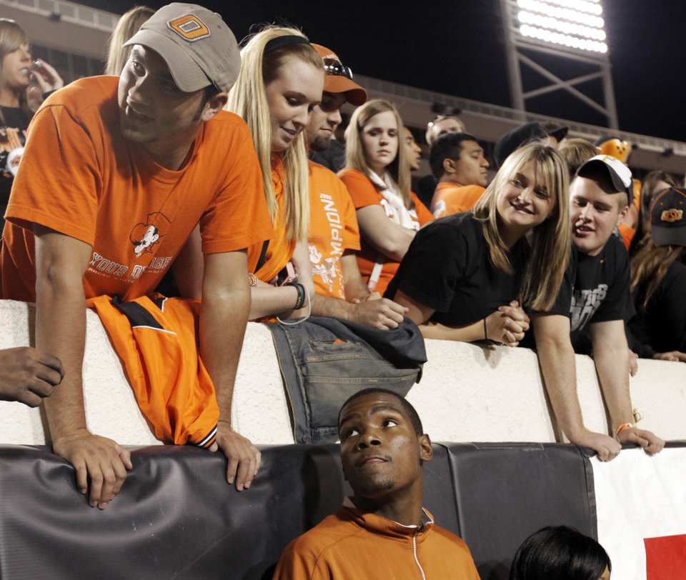 Photo - Kevin Durant of the Oklahoma City Thunder looks up at OSU fans during the college football game between the Oklahoma State University Cowboys (OSU) and the University of Texas Longhorns (UT) at Boone Pickens Stadium in Stillwater, Okla., Saturday, Oct. 31, 2009. Photo by Nate Billings, The Oklahoman