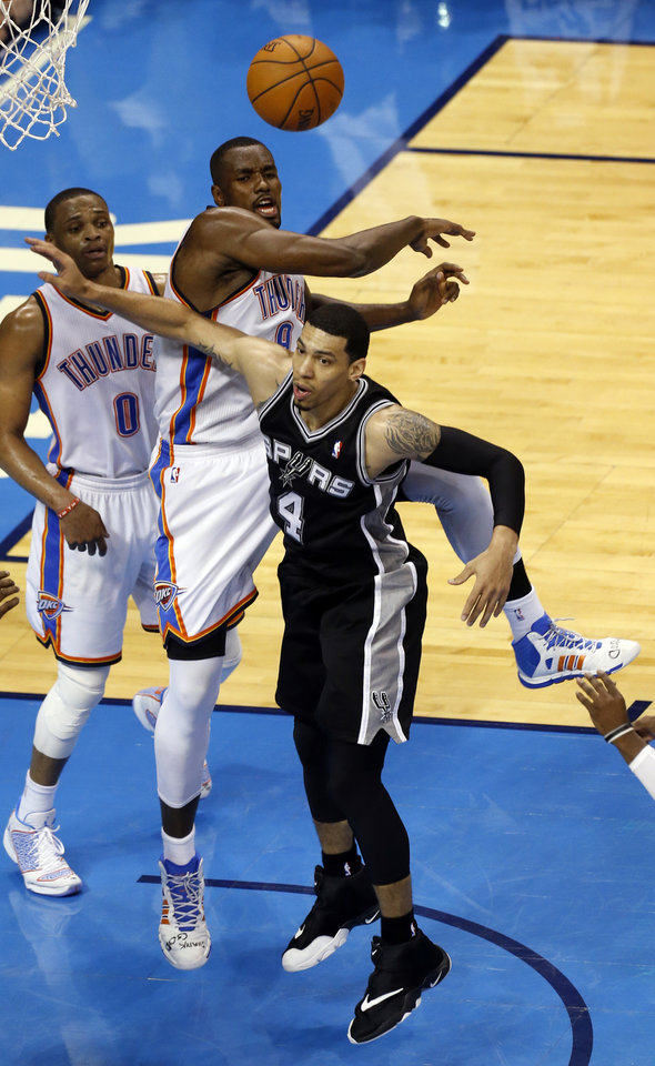 Oklahoma City's Serge Ibaka (9) defends against San Antonio's Danny Green (4) during Game 3 of the Western Conference Finals in the NBA playoffs between the Oklahoma City Thunder and the San Antonio Spurs at Chesapeake Energy Arena in Oklahoma City, Sunday, May 25, 2014. Photo by Nate Billings, The Oklahoman